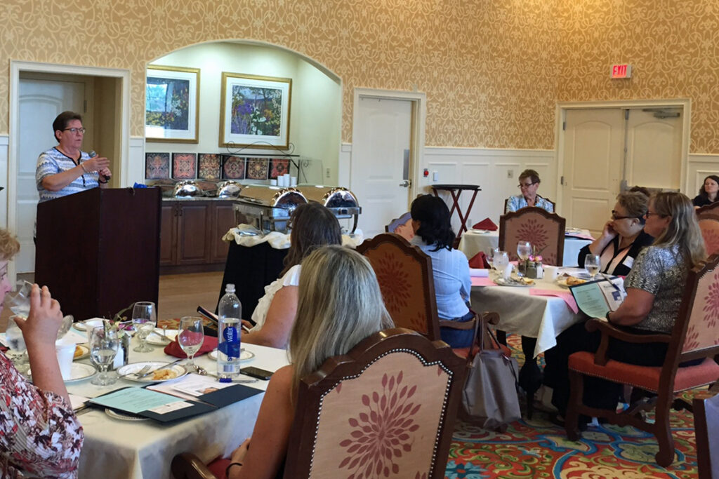 Nancy Partin of the CARES unit, Palm Beach County, updates attendees on the Medicaid managed care program.
