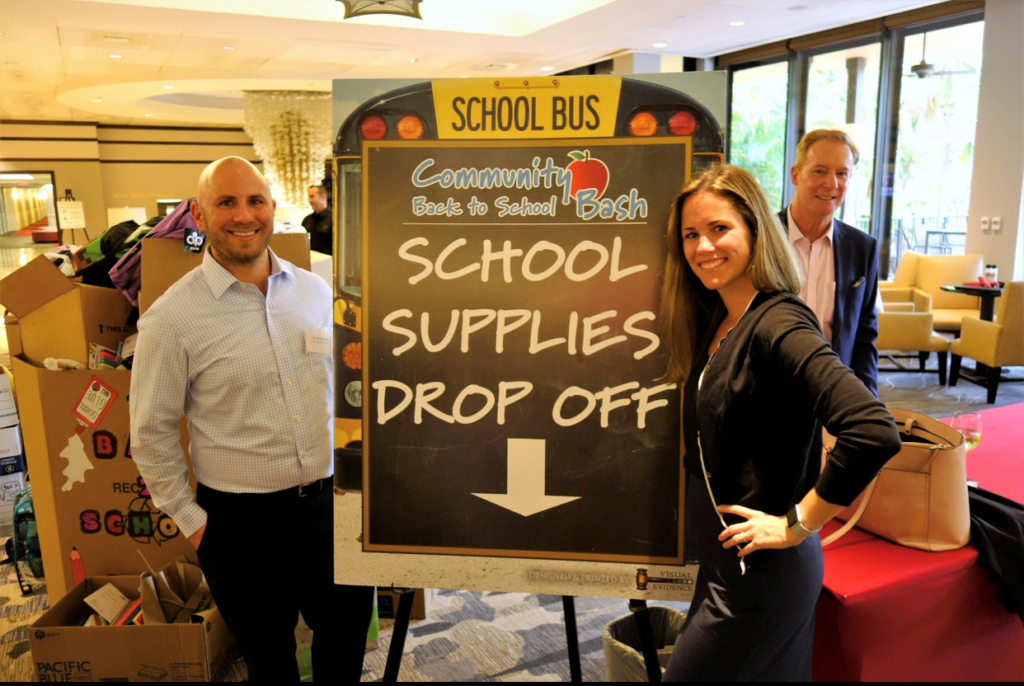 Attorneys Jonathan Karp and Cara Stropp delivered several boxes of collected school supplies to the event.