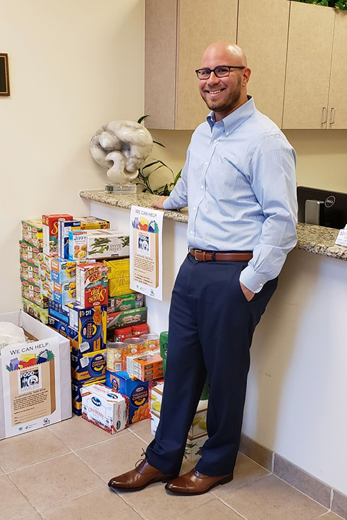 Attorney Jonathan Karp with some of the 401 pounds of nonerishable foods donated by our attorneys and staff.
